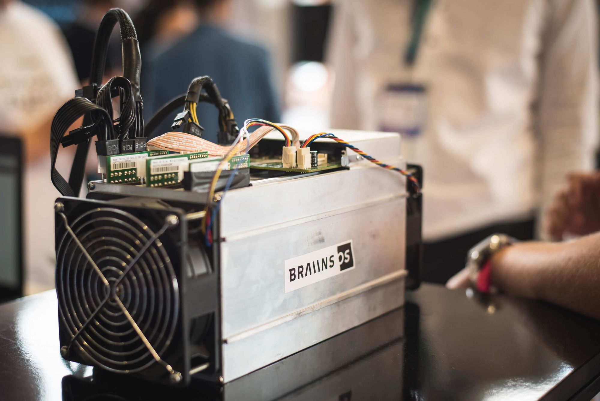 A single Antminer S9, manufactured by Bitmain, is small enough to fit in one's home. By Braiins.